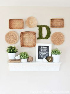 These li'l baskets are so cheap.  Could be a cute way to display the girls' artwork.