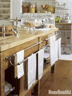 Designer Susan Dossetter turned an antique baker's table into a kitchen island in a San Francisco kitchen. The vintage French towel racks were added on and the baker's table came with a new sycamore top. kitchens, towel racks, wood, tea towels, kitchen towels, hous, dish towels, kitchen islands, cake plates