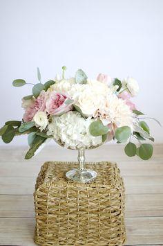 Pink and cream arrangement in a silver pedestal bowl. | by Gavita Flora #wedding #flowers