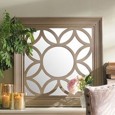 With interconnecting circles and modified diamonds, this mirror's eye-catching geometric print adds up to beautiful wall décor! #kirklands