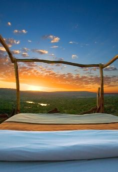 """Get an unobstructed view of the wilderness in Laikipia, Kenya, and sleep under the stars in this """"star bed""""."""
