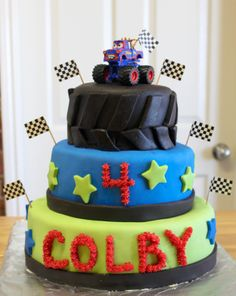 Monster Truck Cake - Monster truck birthday cake for my son's 4th birthday.  He chose one of his toy trucks to use as the topper.  MMF with buttercream letters & number.  My first time covering cakes with fondant.