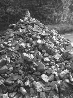 "Ten miles north of Dahlonega, GA, at the intersection of US 19 and State Road 60, is a stone pile in a triangle where the roads cross, known as the Stone Pile Gap. ""This pile of stones marks the grave of a Cherokee princess, Trahlyta,"" reads the Georgia Historical Commission marker standing guard."