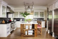 Celebrity Kitchens : Celebrity Style : Architectural Digest celebrity style, pot racks, architectural digest, wood, kitchen design, kitchen ideas, kitchen islands, white cabinets, dream kitchens