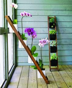 great space saver for people who live in apartments and have a small porch. flowers on ladder!