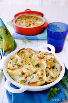Baked stuffed shell pasta with ricotta, chicken and spinach