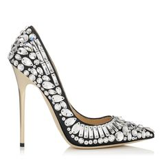 Jimmy Choo Tia Pumps in Black.   Carefully selected Swarovski crystals have been hand applied to follow the contours of the foot. Heel measures 120mm/4.7 inches