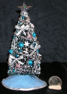 Six inch Miniature Christmas Tree with Blue Decorations. $30.00, via Etsy.