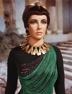 Photographer Bobby Doherty inserted items from the season's runways into stills from iconic movies, from Belle du Jour to American Hustle. Elizabeth Taylor in Cleopatra, 1963. Top by Stella McCartney, 2014.