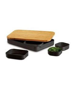 Bento Cut and Prep Set: If you're always rushing to get dinner on the table, use this bamboo cutting board to chop everything ahead of time. Store prepped ingredients in five measuring cups that nest inside the base.