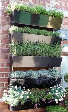 Garden Wall - metal planters on brick