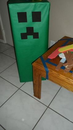 easy minecraft cake ideas | homemade Creeper decoration. Simply a tall box wrapped in green ...