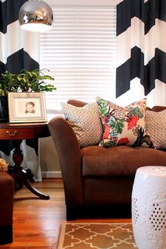 black and white curtains and something interesting on that microfiber brown couch  make my couch better?