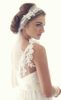 Stunning bride.  Gorgeous dress, hair, makeup and veil.