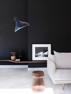 black brick wall via THE STYLE FILES