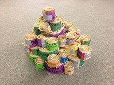 """Happy Birthday #Girl Scouts! Our service project was to make these """"cat scratchers,"""" which are made out of recycled Girl Scout Cookie boxes for our local humane society! The girls decided to make a birthday cake out of them honoring their 101 year celebration!"""