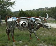 Bull sculpture from recycled auto parts:
