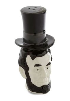 A pepper-filled black hat stacks atop a presidential head that holds salt, offering honest-to-goodness eye-catching décor even when not in use.