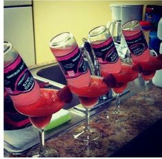 Strawberry daiquiri with miles hard! MmmmBachelorette Party - 1.4 oz of tequila, margarita mix, blended with ice, add mikes hard pink lemonade...I might just have this as a pre-wedding jitter drink or as a complimentary beverage for my guest