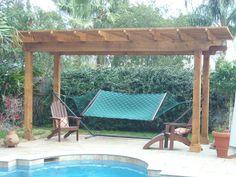 Pergola over hammock in Sugar Land Greatwood by Texas Custom Patios