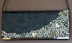 Dress up a thrift store clutch with old broken jewelry ... cheap and chic!