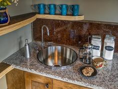 The bar features a stainless steel circular sink.
