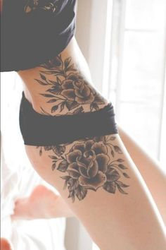 Something similar to this to pull my anchor tattoo on my ribs & my initial tattoo on my stomach into one piece that extends down my thigh, but maybe dogwood instead of roses.