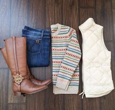 Cable knit sweater and white vest with riding boots