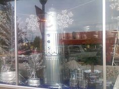 No Excuses for Boring Window Displays! This snowman made from galvanized trash cans is an eyecatching way to capture those clean out & organize dollars this winter!!!