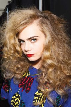 Big voluminous hair and red lip