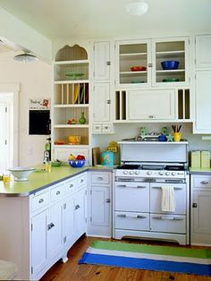 White kitchen with Fiestaware.  Love that stove.