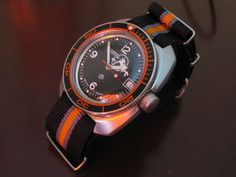Amphibia in ministry case, orange NATO strap and bezel mod