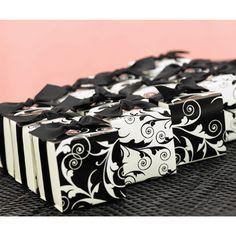 "Reversible Flourish Wrap Favor Boxes:   White favor boxes with reversible wraps feature a black and white flourish design. Black, 5/8"" pre-cut, satin ribbon and double-sided tape are included."