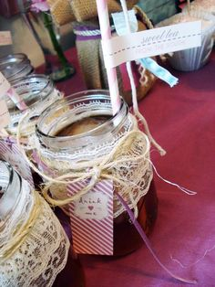 I love how these mini mason jars are decorated with lace and twine