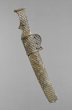 Short sword and scabbard ca. 6th–7th century A.D. Iran. Sasanian. Silver (scabbard and hilt), iron (blade). H. 1.9 x W. 6.1 x L. 30.2 cm). Metropolitan Museum Nº 1988.102.44