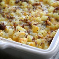 Cheesy Potato Breakfast Casserole1 pound Johnsonville Mild Italian Sausage, cooked 1 yellow onion, chopped, sauteed in sausage grease 7 eggs 1/2 cup milk 20 ounce bag frozen Ore-Ida Diced Hash Browns 8 ounce brick of Mild Cheddar Cheese, grated Salt & Pepper, to taste