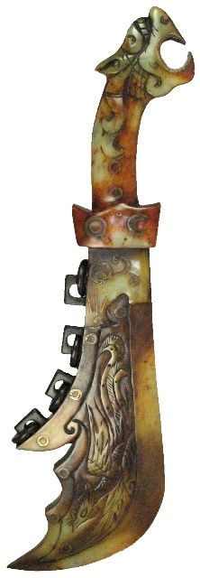 Sadigh Gallery's Ancient Chinese Jade Ceremonial Sword with a Dragon. Carved jade sword with dragon head handle. Four rings and carved animals on the curved pointed blade. Song Dynasty. 1100 AD