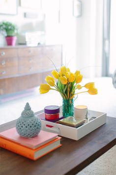 coffee table styling idea. Tray, candle, books, knickknack.