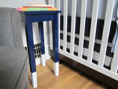 Easy DIY: Paint side table a fun color with glossy paint, then dip the legs in white (or a contrasting color)! #nursery