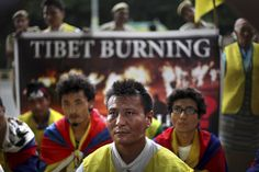 Exiled Tibetans listen to a speaker during a peaceful prostration march on the road leading to the U.N. Information Center in New Delhi, India. (AP)