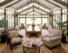 Green house inspiration - clean, organized and doubles as a sitting room im the front.  Traditional | Martha O'Hara Interiors