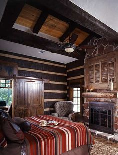 earth toned western decor..I would give anything for a fireplace in my bedroom!