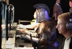 Gamers, with one dressed a character from the game, playing the Dark Souls II game at the Eurogamer Expo at Earls Court in London, September 26, 2013. (Photo by Philip Toscano/PA Wire)