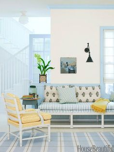 Pattern play. Designer: Alexandra Angle. Photo: Victoria Pearson. housebeautiful.com #mixingpatterns #blueandyellow