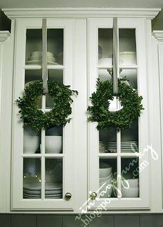Boxwood wreaths:::love to put Christmas everywhere
