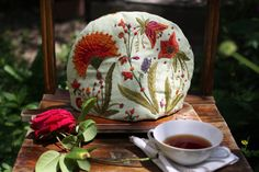 Most beautiful embroidered linen tea cosy, $70 from Onok Wild Yard on Etsy.
