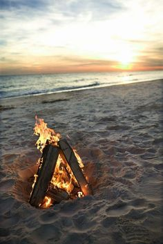 Fire on the beach at sunset