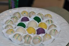 Banana Foster Cake Balls. Banana Foster originated from New Orleans and the baby shower was Mardi Gras themed. Made by my sister (Confection Affection Bakery on Facebook). She adapted this recipe for the cakeballs but used only about 1/4 at most of the frosting recipe. http://www.tasteandtellblog.com/bananas-foster-cake-bites/