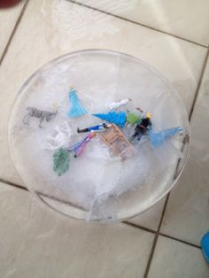 #Frozen toys in ice block for a #party #game Toys are from the Frozen busy book