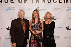 "monterey media inc.'s Scott Mansfield and Jere Rae Mansfield with ""Trade of Innocents"" star and Academy Award Winner, Mira Sorvino"